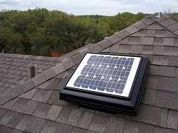 A solar powered attic fan or roof vent like this one is not as powerful as an electric fan but does greatly improve air flow in the attic space.