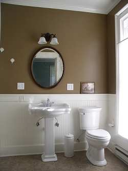 Bathroom Decorating Ideas on Sink And White Wainscoting Give This Country Bathroom Style And Flair