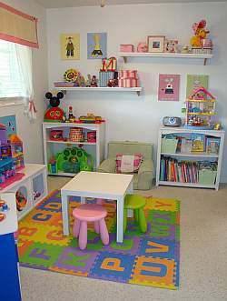 shelves and storage help keep the playroom uncluttered and well
