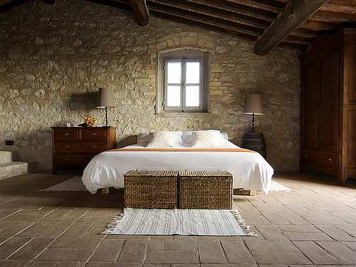 Tuscan decor creates old world flavor raftertales home for Tuscany bedroom designs